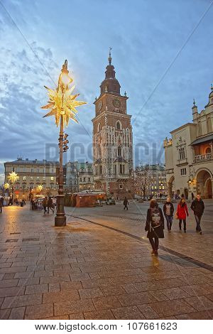 Krakow, Poland - January 8, 2014: Cloth Hall and Town Hall Tower in the Main Market Square of the Old City in Krakow in Poland at Christmas time
