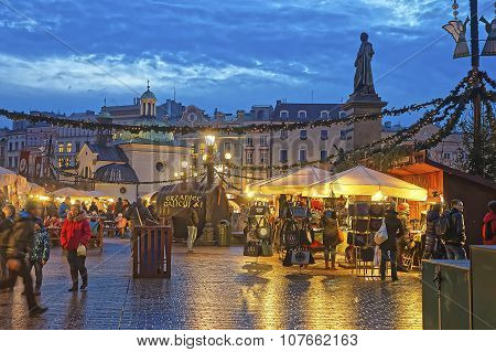 Traditional Street Market Near Church Of St Wojciech And Statue Of Polish Poet Adam Mickiewicz In Th