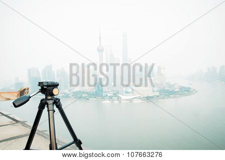 Tripod on the background of modern city