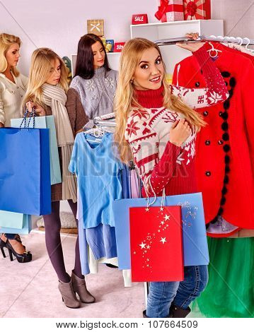 Shopping women at Christmas sales holding shoppind bags.