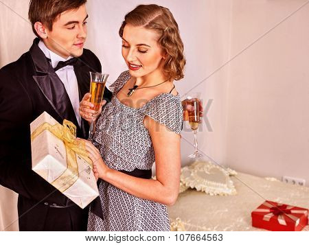 Couple on party drinking champagne . Black and white vintage style.