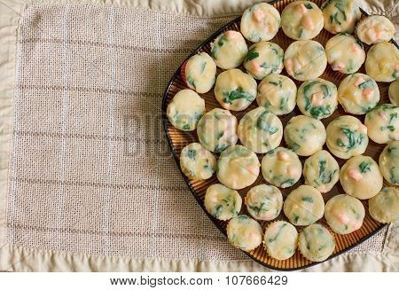Heap of homemade muffins with salmon, spinach and cheese