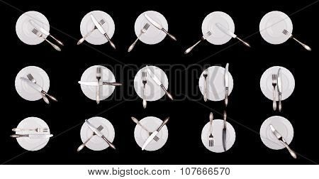 Set of etiquette signs: plate, knife, fork isolated on black