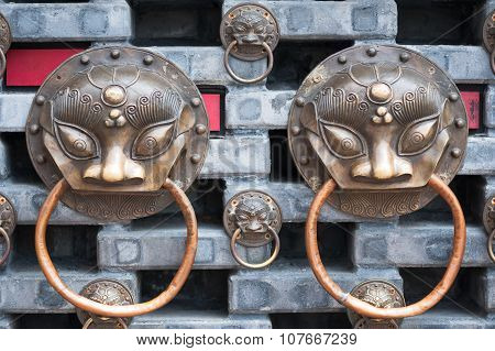 Chinese Knockers On A Wall