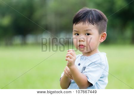 Little asian boy feeling itchy and scratching on him arm