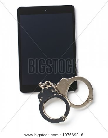 handcuffs and tablet on white background
