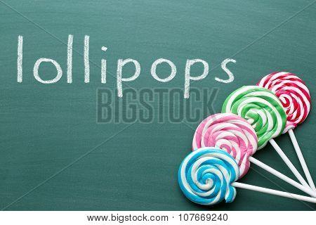 colorful swirl lollipop on chalkboard