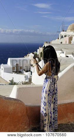 Chinese Tourist In Oia On Santorini Island