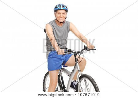 Senior with a blue helmet posing seated on a bicycle isolated on white background