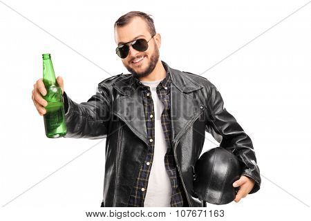 Young male biker in black leather jacket holding a bottle of beer and looking at the camera isolated on white background