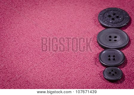 Dark Buttons On Red Textile With Space For Inscription