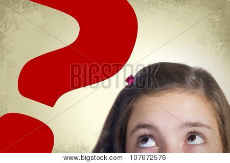 Close Up Teenage Girl Looking To Big Question Mark
