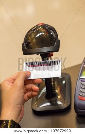 Black Barcode Scanning Member Card On Human Hand