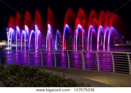 Water fountains on night background in Smart City Malta. Dancing water fountains. Colourful water fo