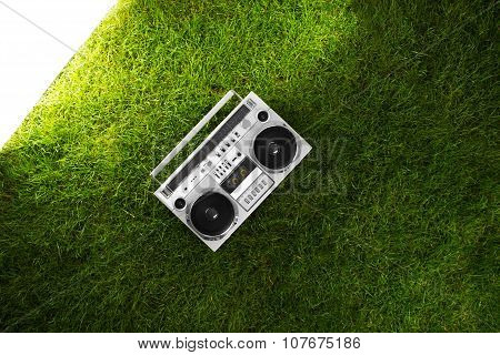 Retro Boom Box Receiver Over Fresh Green Grass