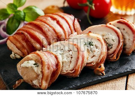chicken breast stuffed  feta cheese and herbs wrapped in bacon