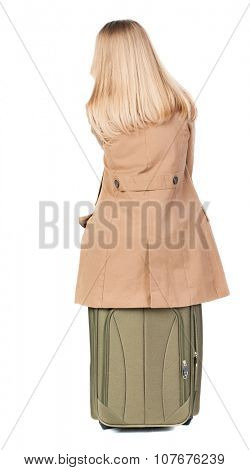 back view of woman  in cloak sits on a suitcase. beautiful  girl in motion.  backside view of person.  Rear view people collection. Isolated over white background.