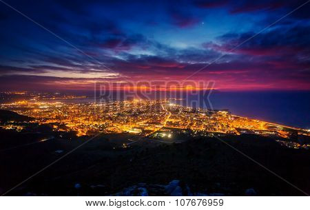 Fantastic aerial view of city illuminated with lights. Dramatic and picturesque scene. Location Trapani, Erice, Sicilia, Italy, Europe. Mediterranean and Tyrrhenian sea. Beauty world.