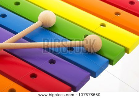 Rainbow Colored Wooden Toy Xylophone Against White Background