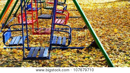 Several Swing For Children In Autumn Park