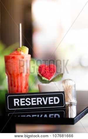 Vintage Styled Image Of A Reserved Sign On A Table In Restaurant