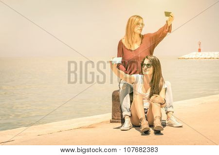 Hipster Girlfriends Taking A Double Selfie At Wharf Docks - Concept Of Friendship And Fun