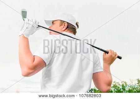 Man Holding A Golf Club Behind His Back