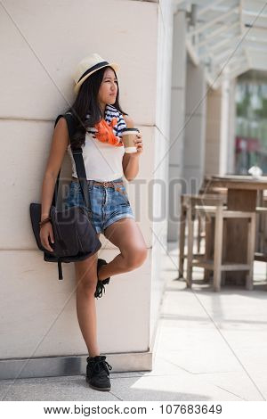 Female student drinking coffee