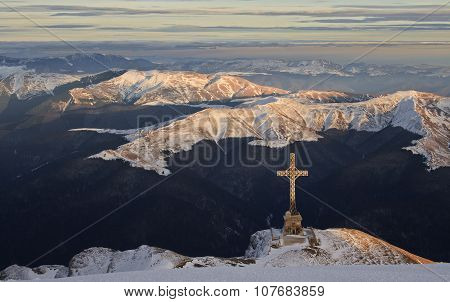 Big cross over the valley in winter