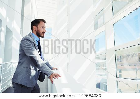 Intelligent male managing director thinking about something while rest after work