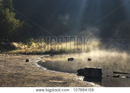 Steamy lake in the forest