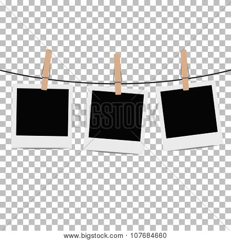 Photo frames hung on rope with clothespins on transparent background. Vector illustration.