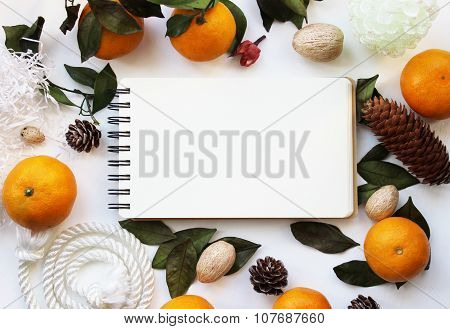 Mockup Concept With Mandarines And Pine Cones