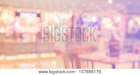 Abstract Blur Background Of Restaurant In The Shopping Mall Made With Filtered Color