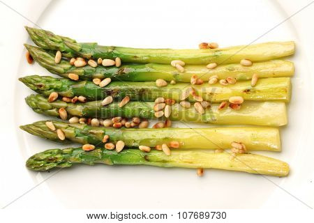 Green asparagus with pine nuts.