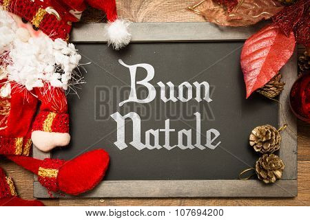 Blackboard with the text: Happy Christmas (in Italian) in a conceptual image
