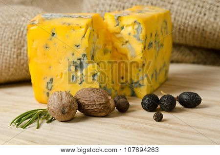 The Nutmeg With Cheese On Wooden Table