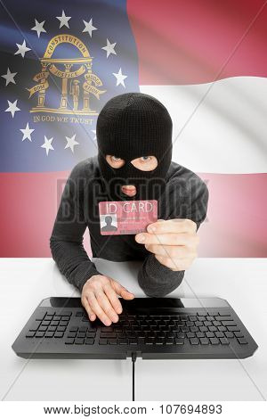 Hacker With Usa States Flag On Background And Id Card In Hand - Georgia