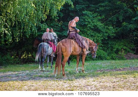 Zaporizhzhya Cossacks On Horseback Against A Background Of Trees