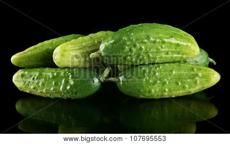 Many Fresh Raw Gherkins Isolated On Black