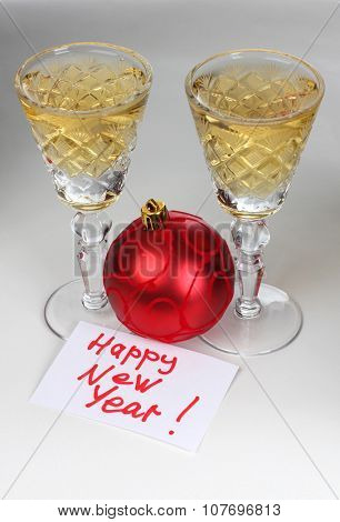 Christmas toys and wineglasses on table