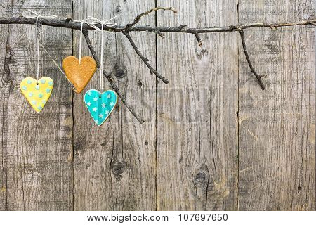 Gingerbread Hearts Hanging Off A Bare Branch