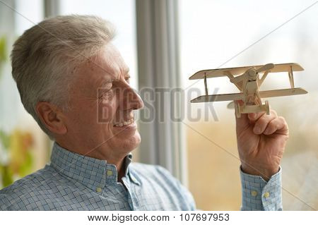 man with wooden plane