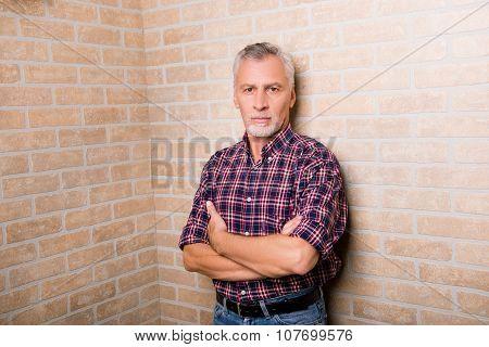 Handsome Old Man Standing Near The Corner