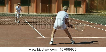 Senior couple on tennis