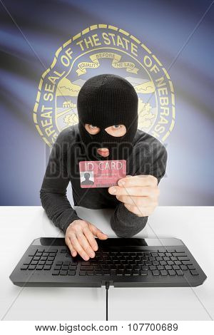 Hacker With Usa States Flag On Background And Id Card In Hand - Nebraska