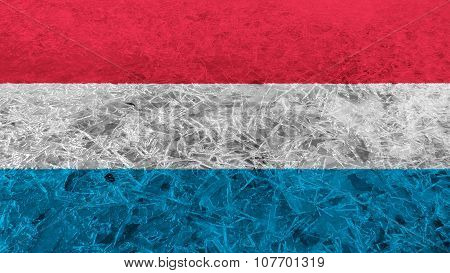 Flag of Luxembourg painted on ice texture