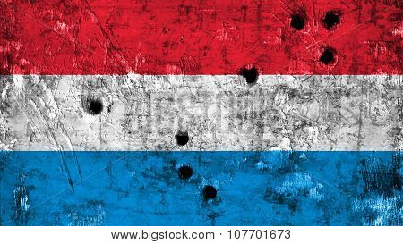 Flag of Luxembourg painted on metal with bullet holes