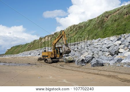 Mechanical Excavator Working On Coastal Protection