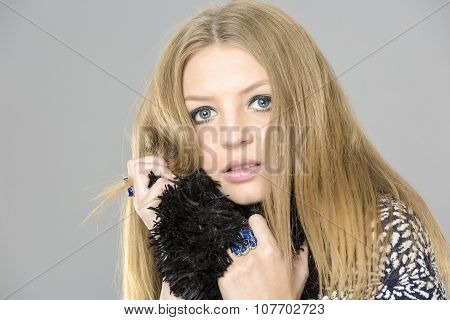 Portrait of wonderful young blonde woman with long hair looking at camera, smiling.